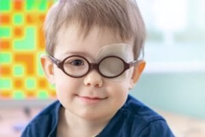 Young child wearing an eye patch while undergoing vision therapy